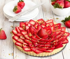 """A """"pasta frolla"""" shell filled with a silky-smooth lemon pastry cream and topped with juicy strawberries"""
