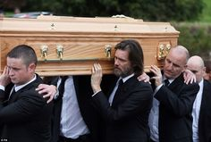Jim Carrey, pictured center, carried his ex-girlfriend Cathriona White's coffin from her Requiem Mass on Saturday with members of her family