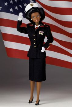 """Marine Corps Barbie  Special Edition  Release Date: 1/1/1992  Product Code: 07594  Meet Sergeant Barbie® doll, dressed in a replica of an authentic Marine Corps """"Dress Blues"""" uniform for enlisted women, worn to all official formal Marine Corps events. Her uniform consists of a matching navy-blue jacket with golden buttons and red trim, matching blue skirt, white gloves, hat, and blouse."""