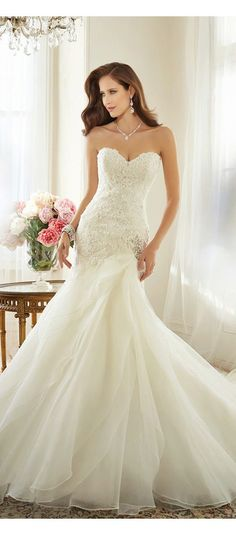 The newest collection from Sophia Tolli is elegant, dreamy and exactly what of what you would imagine a wedding gown to be. The 2015 Sophia Tolli will not disappoint, so breeze through all thee gowns to find the one that best fits your style. We must say that the gray tulle with the beaded sleeves is one of our personal favorites.