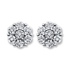 Tightly nestled round diamonds resemble brilliant flowers in each of these elegant earrings for her. Styled in sterling silver, the earrings have a total diamond weight of 1/15 carat and are secured with friction backs. Diamond Total Carat Weight may range from .065 - .08 carats.