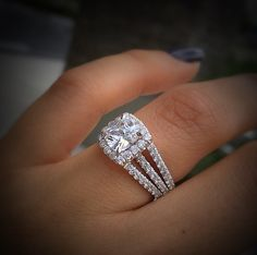 This Gabriel & Co. 14k White Gold Diamond Halo Engagement Ring Setting captivates your eyes with 3 rows of pave set diamonds leading up to your perfect center stone.