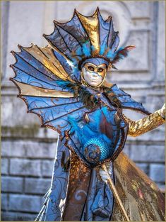 Carnevale, beautiful blue and gold woman.