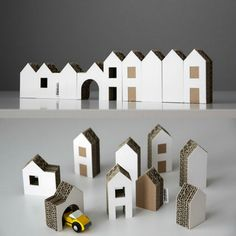 We have a feeling that this simple, beautiful set of cardboard houses will appeal to little and big kids alike.Perfect as decoration but also as a small art toy, the little Czech town is composed of nine different-sized houses made from a mix of white and brown card and corrugated cardboard. The largest house stands 9cm tall and all of the buildings are approx. 2.8 cm deep. The set comes in a simple brown cardboard box measuring 20 x 14 cm.Designed by Michaela Horáčkov...