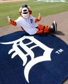 The Detroit Tigers mascot Paws poses for a photo prior to the game against the Kansas City Royals at Comerica Park on April 2 2014 in Detroit...