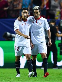 Wissam Ben Yedder (L) of Sevilla FC celebrates with his team mate Samir Nasri of Sevilla FC after scoring his team's first goal during the UEFA Champions League Group H match between Sevilla FC and Olympique Lyonnais at the Ramon Sanchez-Pizjuan stadium on September 27, 2016 in Seville, Spain.
