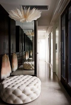 Bec Judd's dreamy walk-in closet, complete with tufted ottoman and polished concrete floors—and that light fixture! Walk In Closet Design, Wardrobe Design, Built In Wardrobe, Closet Designs, Walking Closet, Rebecca Judd, Interior Design Institute, Bedroom Cupboard Designs, Closet Lighting