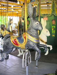 "two of the rabbits at The ""Antique Carousel"" at the Centreville Amusement Park.  Centre Island, Toronto, Canada."