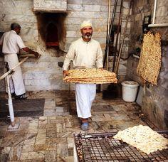 Bakers baking Sangak - Iranian traditional bread