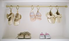 Baby Shoe Organization Hack - tension rod, small curtain hooks and a can of gold spray paint