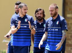 (L-R) Leonardo Bonucci, Andrea Pirlo and Daniele De Rossi of Italy during a training session at Coverciano on June 2, 2014 in Florence, Ital...