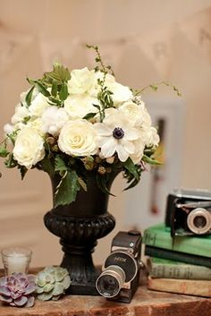 urn bouquet - put bridesmaid bouquets in low, small urns to double use flowers as the mid-height table centerpieces!