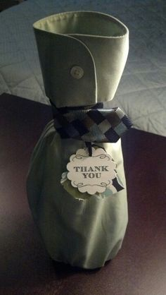 Hostess or thank you gift. Wine bag made from a men's dress shirt sleeve with a necktie tie.