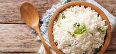 Cauliflower rice with basil close up in a bowl on the table