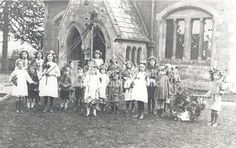 May Day In Ashley, around 1920. This photograph, showing children standing around a maypole celebrating May Day at Ashley church, was taken by Walter Bale of Kibworth.   Ashley is 5 miles north east of Market Harborough and settlement of this area dates back to the Roman times. Most of the children are wearing floral head dresses and a doll is carried in a garland of flowers symbolising new life. May Days, Beltane, Flower Garlands, New Life, Family History, Dates, Roman, Doll, Children