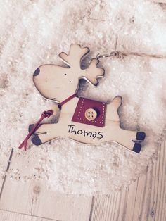A personal favourite from my Etsy shop https://www.etsy.com/uk/listing/482695245/personalised-hanging-wooden-reindeer