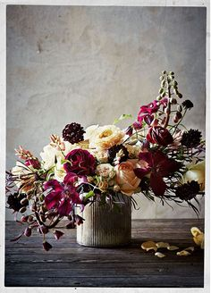 Sullivan Owen for BHLDN // yellow, plum wine Ranunculus + Clematis