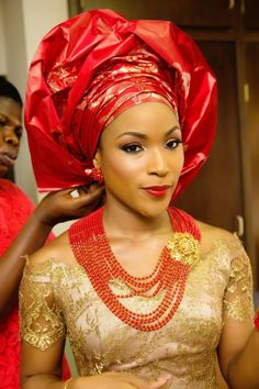 Traditional Igbo Wedding by Alakija Studios. Red and gold Nigerian bride. Gele. necklace. jewelry beads.