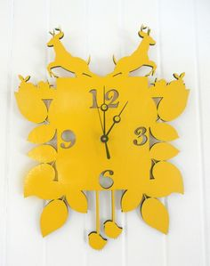 aa modern twist of the old cuckoo clock...add a splash of colour to your house! its sure to be a talking point!    made from 7mm thick laser cut ply