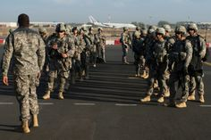 Soldiers of the East Africa Response Force prepare to load onto a U.S. Air Force C-130 Hercules at Camp Lemonnier, Djibouti, on Dec. 18, 2013. Two U.S. C-130 aircraft moved personnel from Juba, South Sudan, to Nairobi, Kenya. Micah Theurich/Courtesy U.S. Air Force U.S. Air Force