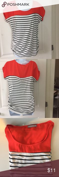 Olivia Moon top Black and white strips. Top portion is orange. Raunching on sides Olivia Moon Tops