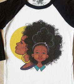 Collaboration T-shirt between Keturah Ariel and Alexandra Elle of alexelle.com. A colorful image depicting Mothers and daughters.Now Available in black and white raglan. Poly/Cotton blend.$25 Unisex Sizes: xs, s, m, l, xl, 2x