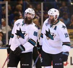 San Jose Sharks' Brent Burns left, and Joe Thornton have a conversation during a break in the action while leading against the St. Louis Blues in the third period of Game 2 of the NHL Western Conference finals. Brent Burns, Joe Thornton, Nhl Hockey Jerseys, Shark S, Western Conference, Jonathan Toews, San Jose Sharks, Hockey Players, St Louis