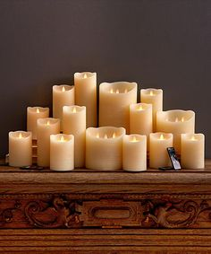 Dazzler 18-Piece Flameless Candle Collection These candles offer the convenience and safety of LED mood lighting but don't lose the romance of authenticity. A five-inch wax pillar candle in soft ivory with a classic, slightly antiqued outer texture, this piece fits most standard holders and hurricanes, providing a convincing look of flame in a large 18 piece collection that is ideal for use in an unused fireplace, a wedding or any special event that candles without the risk of an actual…