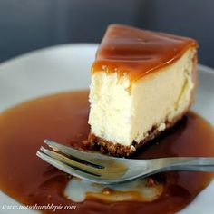 "White Chocolate Caramel Cheesecake ""How can one not love a cheesecake brazen enough to incorporate nearly a pound of white chocolate and then slather the whole pie in caramel sauce?!"" ;-)"