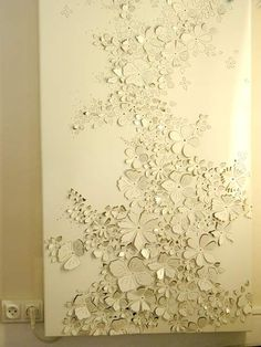 Sheet metal, flowers hand cut and filled away sharp edges. Stunning during day, even better at night due to lights!