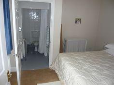 Ground floor bedroom with ensuite wet floor shower room.