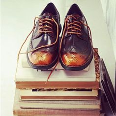 97957ca36b0 Pair of shoes on books How To Look Handsome