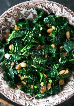Wow! Sautéed Greens with Pine Nuts and Raisins. Recipes like these make it too easy to eat healthy! #healthyeating #healthyrecipe #recipes www.sallingtate.com