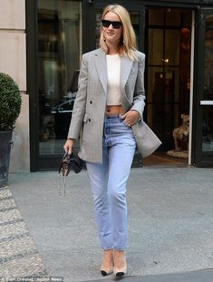 Rosie Huntington-Whiteley displays her abs in tasteful cream crop top as she steps out in New York | Daily Mail Online