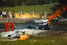 Jackie Stewart driving through the wreckage of Jackie Oliver's BRM and Jacky Ickx's Ferrari after they collided at the Spanish Grand Prix in 1970. Both drivers escapes with relatively minor injuries.