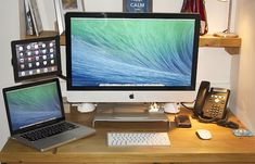 Mac desk setup of a cloud architect and small business owner
