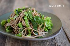 Soba Noodle salad with different greens and sesame soy dressing. Sweet, tangy and nutty - the perfect combination of flavors.