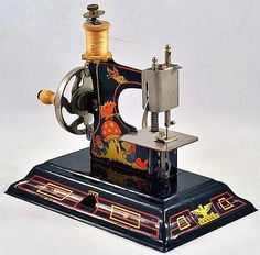 Darling German Casige Vintage Toy Tin Sewing Machine.
