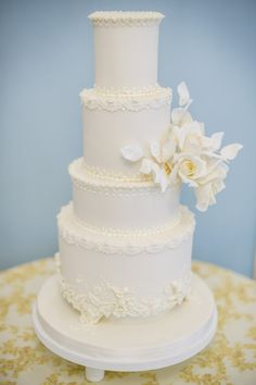 Exquisitely handcrafted 4 tier ivory wedding cake, decorated with intricate royal iced details and beautiful sugar roses.  Image by Catherine Bradley Photography  #luxuryweddingcake #ivoryweddingcake #elegantweddingcake Luxury Cake, Luxury Wedding Cake, Elegant Wedding Cakes, Wedding Cake Designs, Sugar Rose, Sugar Flowers, 4 Tier Wedding Cake, London Cake, Creative Desserts
