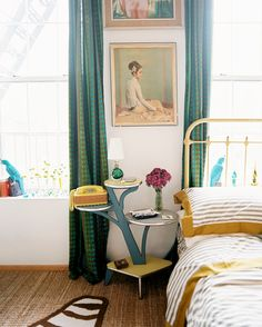 Eclectic Bedroom Photo - A branched side table beside a bed with striped bedding, via Lonny