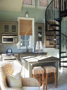 Beach house kitchen : raffia : wicker : stainless steel : staircase in kitchen JTTID