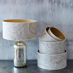 Inspired by beautiful metallic ores and semi-precious crystals, these chic Makrana Lampshades are an eye-catching addition to your favourite table lamp. Exclusive to G&G. Blue Grey Walls, Grey And Gold, Bedroom Lamps, Bedroom Lighting, Bedroom Decor, Office Lighting, Gold Lamp Shades, Small Window Curtains, Gold Table