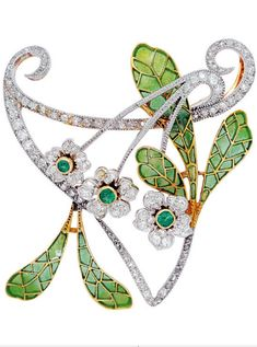 An Art Nouveau Enamel and Diamond Brooch, circa 1905 The delicate trio of florets embellished with emerald pistils and old-cut diamond petals, slender stems and coiling whiplash tendrils, to the green plique-a-jour enamel leaves, mounted in platinum and 18k gold, with pendant loops to the verso, French assay marks