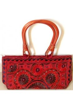 #Mirror Worked And #Embroidered #Red Bag:  This mirror worked and embroidered red bag adds ethnic look while outing for any event. Its floral print and embroidery adds more feminine look.