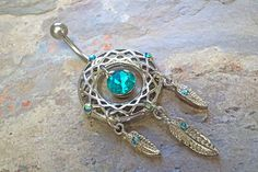 "Teal dream catcher belly button ring . The belly rings barbell is a standard 14 gauge hypoallergenic surgical steel belly piercing accessory that is 3/8"" long. Dream catcher measures 23mm in diameter"