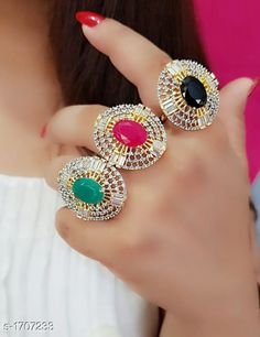 Rings Women's Alloy Gold Plated Rings Material: Alloy  Size: Free Size (Adjustable) Description: It Has 3 Piece Of Finger Ring Work: Stone Work Country of Origin: India Sizes Available: Free Size *Proof of Safe Delivery! Click to know on Safety Standards of Delivery Partners- https://ltl.sh/y_nZrAV3  Catalog Rating: ★4 (6457)  Catalog Name: Women's Partywear American Diamond Rings CatalogID_223180 C77-SC1096 Code: 672-1707233-