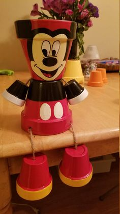 Hand painted Mickey clay pot. These products are hand painted clay pots, made into a person. All of my products are sealed, roped, and super glued twice. Custom orders are always welcome. Although the clay pots are sealed, I wouldnt recommend them staying outside in harsh conditions, for