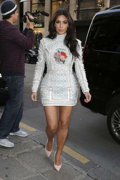 Kim Kardashian West continued her love affair with Balmain in a pearl-embellished white minidress wh... - Rex USA