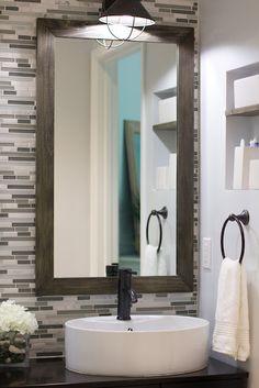 Bathroom backsplash with framed mirrors