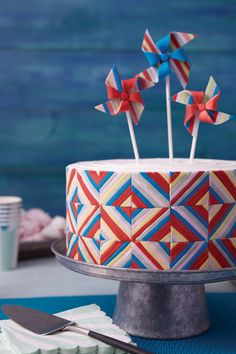 Put color in motion on a cake that combines a classic American quilt pattern with a trio of breezy pinwheel toppers. Use the Color Right Performance Color System to tint the cool summer shades and create your own patchwork arrangement with fondant on the cake sides.
